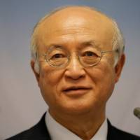 International Atomic Energy Agency (IAEA) Director General Yukiya Amano addresses a news conference after a board of governors meeting at the IAEA headquarters in Vienna Monday. | REUTERS