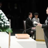 Prime Minister Shinzo Abe addresses a government-sponsored memorial service in Tokyo on Saturday to mark the sixth anniversary of the massive March 11, 2011, earthquake and tsunami. | KYODO