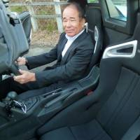 Mineo Takase, president of auto parts manufacturer Bride, developed his first product after taking apart a Europe-made racing car seat to learn how it was made . | KYODO