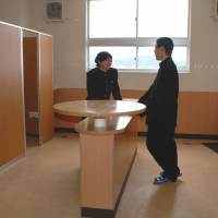 Students chat at a table in the bathroom of a high school in Shiga Prefecture. | CHUNICHI SHIMBUN