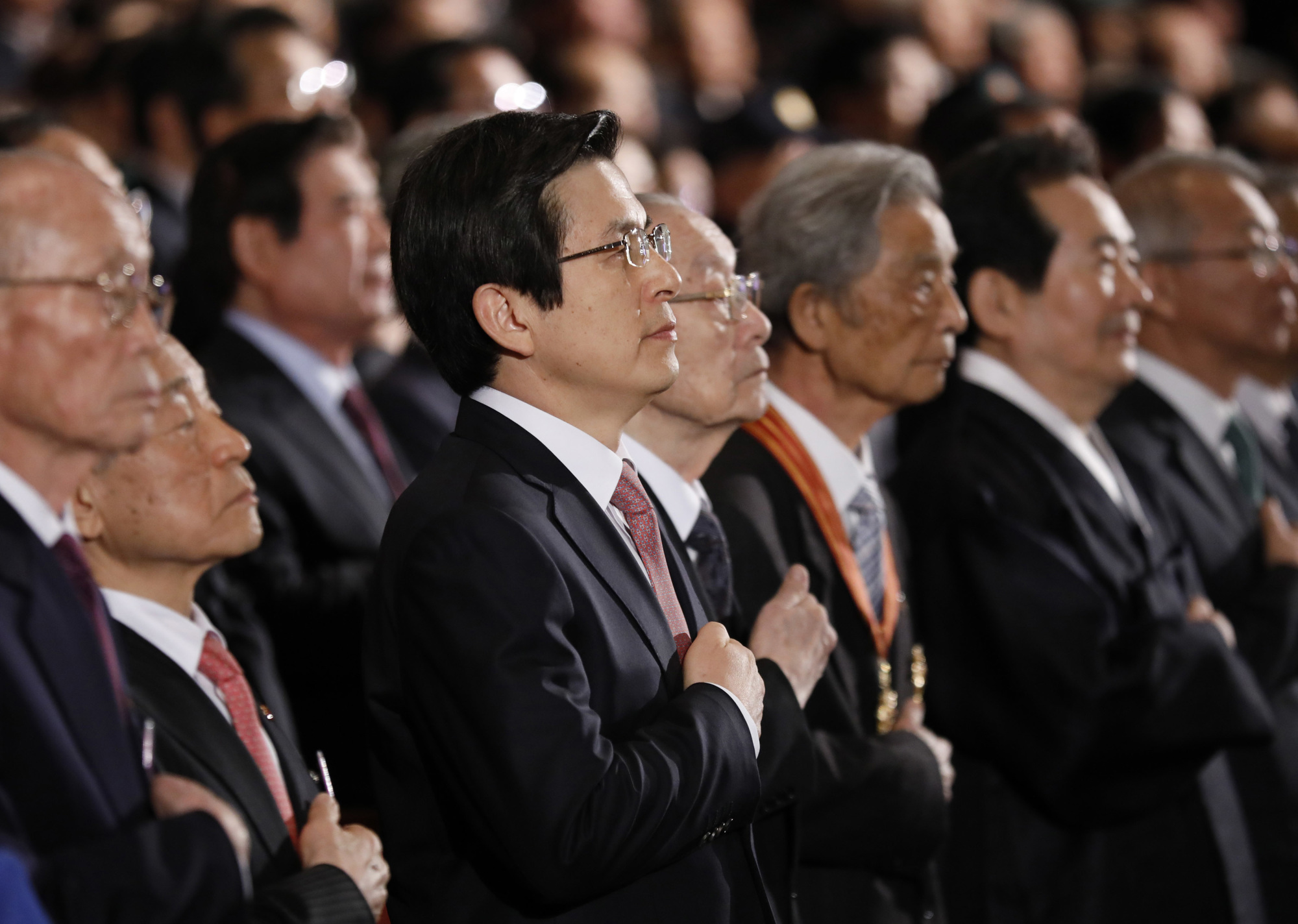 South Korean Prime Minister and acting leader Hwang Kyo-ahn (center) attends a ceremony to mark the anniversary of the 1919 Independence Movement against Japanese rule over the Korean Peninsula in Seoul on Wednesday. | AP