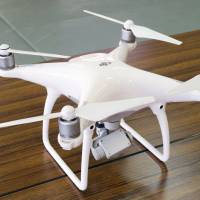 A drone confiscated from a man who allegedly flew it in a prohibited area in Kitakyushu is shown to the media Friday at a police station in the city. | KYODO