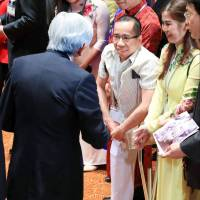 Surviving Vietnamese twin meets Emperor, Empress