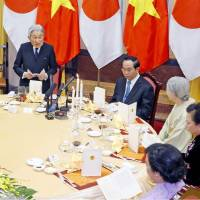 Emperor Akihito speaks at a banquet sponsored by Vietnam President Tran Dai Quang in Hanoi on Wednesday. | POOL / VIA KYODO