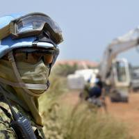 A Ground Self-Defense Force member stands guard during road construction in Juba in July 2015. GSDF troops are expected to withdraw from South Sudan in May. | KYODO