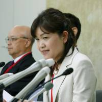 Sachiko Kishimoto, head of nonprofit organization OD-Net, attends a news conference in Tokyo on Wednesday. | KYODO