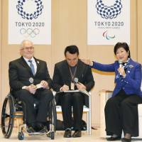 International Paralympic Committee President Philip Craven (left) and Tokyo Gov. Yuriko Koike (right) hold talks at the metropolitan government building in Tokyo on Feb. 23. | KYODO