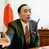 Grilled over Osaka land deal, Abe balks at demand for probe into LDP