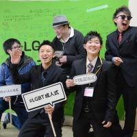 Participants pose at a coming-of-age ceremony catering to lesbian, gay, bisexual and transgender people on Feb. 12 in the city of Saga. | KYODO