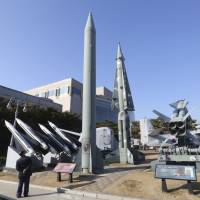 A mock North Korean Scud-B missile (center left) and South Korean missiles are displayed at the Korea War Memorial Museum in Seoul. North Korea on Monday fired a projectile into the waters off its east coast, South Korea's military said, in an apparent missile test that comes days after Washington and Seoul began huge military drills that Pyongyang insists are an invasion rehearsal. | AP