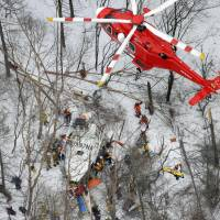 Recovery operations continue Monday after a fire helicopter with nine aboard crashed during a drill Sunday in a mountainous area in Nagano Prefecture. | KYODO