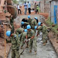 Ground Self-Defense Force members engage in street gutter construction in Juba, South Sudan, in March 2013. | KYODO