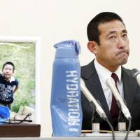 Takatoshi Noritake, who lost his 9-year-old son Keita in an traffic accident caused by a truck driver playing the smartphone game 'Pokemon Go,' faces the media at a news conference Wednesday in Ichinomiya, Aichi Prefecture, after the driver was sentenced to three years in prison. | KYODO