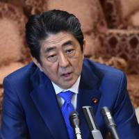Abe slips in polls as skeptical voters urge first lady to testify: survey