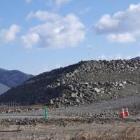 Earth is piled up in the coastal area of Rikuzentakata, Iwate Prefecture, looking like a giant pyramid in the making. | REIJI YOSHIDA