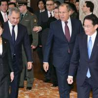 (From right) Foreign Minister Fumio Kishida, his Russian counterpart Sergey Lavrov, Russian Defense Minister Sergei Shoigu and his Japanese counterpart Tomomi Inada prepare to hold the so-called 'two-plus-two' dialogue in Tokyo on Monday. | POOL / VIA KYODO