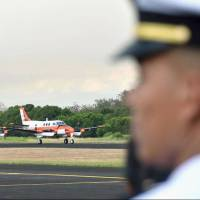 Two TC-90 training planes are lined up at a naval base in Cavite province, south of Manila, on Monday. | KYODO