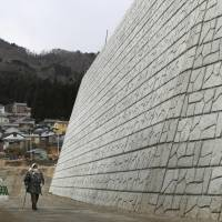 Just 22% of new seawalls are finished in areas hit by 2011 tsunami