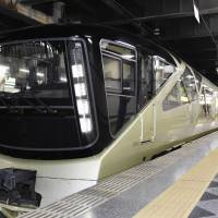 JR East's new Train Suit Shiki-Shima luxury sleeper train is seen at JR Ueno Station in Tokyo on Thursday. The train had to suspend its trial run Monday due to apparent engine trouble. | KYODO