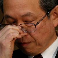 Toshiba President Satoshi Tsunakawa attends a news conference at the company's headquarters in Tokyo on March 14. | REUTERS