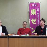 Chris Beardshall (left), Louis Carlet and Adam Cleeve, members of the Zenkoku Ippan Tokyo General Union, hold a news conference Thursday at the labor ministry after Beardshall and Cleeve filed a lawsuit against Shane Corporation Ltd. | DAISUKE KIKUCHI