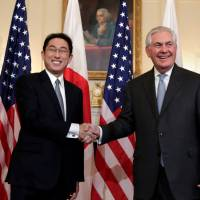 U.S. Secretary of State Rex Tillerson greets Foreign Minister Fumio Kishida before their meeting at the State Department in Washington on Feb. 10. | REUTERS
