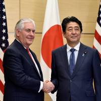 U.S. Secretary of State Rex Tillerson and Prime Minister Shinzo Abe shake hands before their meeting at Abe's official residence in Tokyo on Thursday. | REUTERS