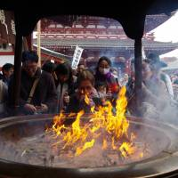 Tourists visit Sensoji Temple in the Asakusa district of Tokyo. An estimated 2.04 million foreign visitors came to Japan in February, according to a government tourism body. | ISTOCK