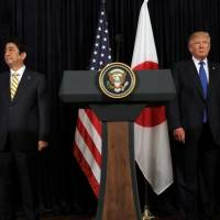 U.S. President Donald Trump and Prime Minister Shinzo Abe leave after delivering remarks on North Korea on Feb. 11 at Trump's Mar-a-Lago club in Palm Beach, Florida. | REUTERS