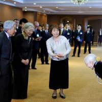 Nguyen Thi Xuan, 93, greets Emperor Akihito and Empress Michiko at a hotel in Hanoi on Thursday during an event held for the wives and offspring of Japanese war veterans who stayed in Vietnam after World War II. | AFP-JIJI