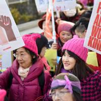 Participants call for women's rights and solutions to harassment during an International Women's Day march in Tokyo's Aoyama district on Wednesday. A total of 200 people took part in the event, according to police. | SATOKO KAWASAKI