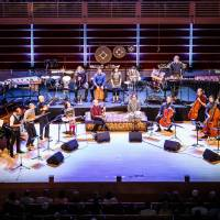 All hands on deck: Yo-Yo Ma (fifth from the right in the front row) and the musicians of the Silk Road Ensemble represent a global array of cultures on stage. | MAX WHITTAKER