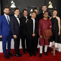 Red carpet: Members of the Silk Road Ensemble arrive at the 59th Grammy Awards on Feb. 12. The ensemble won the award for best world music album. Pictured from left are Johnny  Gandelsman, Reylon Yount, Shane Shanahan, Kojiro Umezaki, Joseph Gramley and, in the front row, Wu Tong, Sandeep Das and Haruka Fujii. | REUTERS