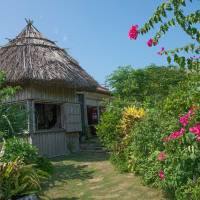 Traditional buildings in the flower bedizened grounds of the Minzoku Mura folk museum. | STEPHEN MANSFIELD