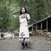 Adopted culture: Although not an Ainu by blood, Magi embraced the indigenous way of life, having lived as an Ainu in a commune in Nibutani for many years. She is skilled in Ainu embroidery, which she incorporates into her hand-made clothes, and she gathers plants in the mountains near her home, where she is pictured. | LAURA LIVERANI / LUNCH BEE HOUSE