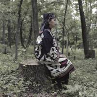 Hachihoji, Tokyo, Japan, 2012. Ainu activist Akemi Shimada wears a traditional Ainu robe she embroidered herself. To avoid discrimination, Shimada hid her ethnic background until the age of 45. She has been an active member of the Ainu community ever since, promoting indigenous rights mainly through cultural activities, such as the Ainu-Maori exchange program. | LAURA LIVERANI / LUNCH BEE HOUSE