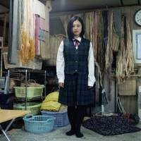 Nibutani, Hokkaido, 2014.  Maya, 15 years old, in school uniform at her grandmother's Attus weaving workshop. Maya was born to an Ainu mother and a Japanese father. | LAURA LIVERANI / LUNCH BEE HOUSE
