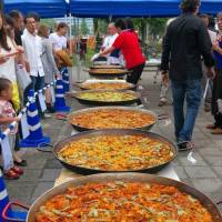 Dishing up the goods: Large bowls of paella wait to be judged (and eaten) at a previous paella festival. | JAPAN PAELLA ASSOCIATION