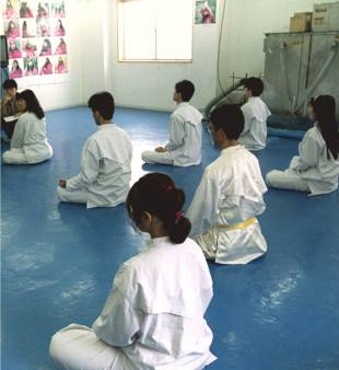 Followers of the Aum Shinrikyo doomsday cult meditate in a room in Fujinomiya, Shizuoka Prefecture, in March 1995.