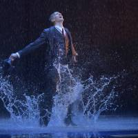 Water dance: Adam Cooper splashes in puddles as Don Lockwood in the musical-theater adaptation of the classic 1952 film 'Singin' in the Rain.' | © AKIHITO ABE