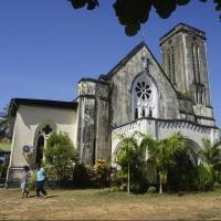 Heritage building: Visitors leave the First Baptist Church in Mawlamyine, which was established in 1827 by one of the first American missionaries to travel overseas. | AP