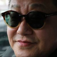 Taxi driver Takehiko Kato rocking one of his many pairs of Tom Ford shades. | KIT NAGAMURA