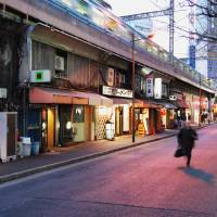 Culture and commerce thrive under Japan's elevated train tracks