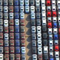 Driving tough trade deals: Although Japan exports cars overseas, such as these awaiting shipment at Yokohama Port, motor journalist Mitsuhiro Kunisawa says that most similar cars bought in America are actually made in the United States by subsidiaries of Japanese companies. | KYODO