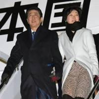 Simple gestures: At public engagements, Prime Minister Shinzo Abe is often seen holding hands with his wife, Akie, a gesture seen to signify that as Japan's first lady, she has the full support of her husband. | KYODO