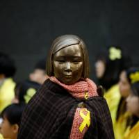 A statue symbolizing former South Korean 'comfort women' is seen during an anti-Japan rally on the 98th anniversary of Independence Movement Day in Seoul on March 1. | REUTERS