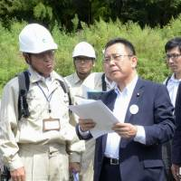 In the thick of it: Industry Minister Yosuke Takagi (right) is exploring a variety of options to boost agricultural areas near the crippled Fukushima No.1 nuclear power plant. | KYODO