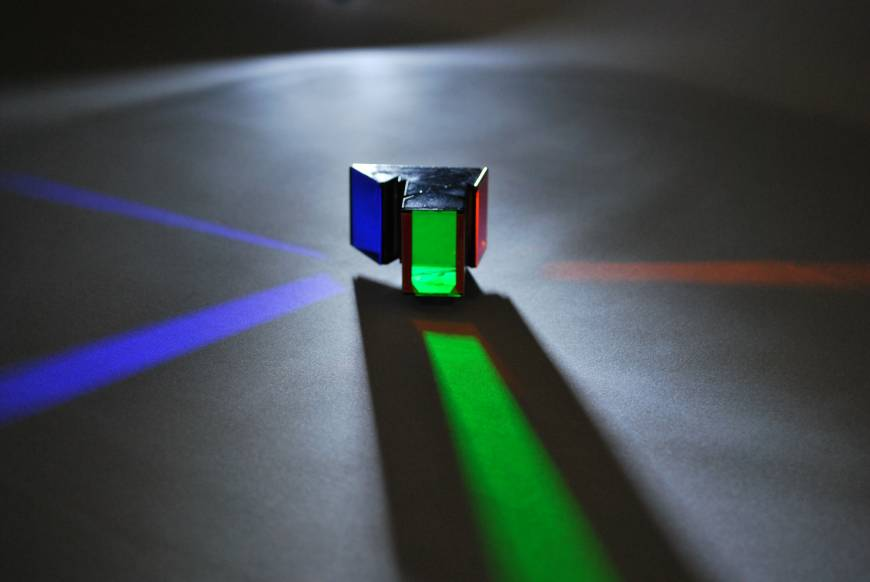 A tricolor prism for 4K and 8K, by Musashi Optical System.