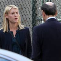 Facing up to the competition: The fifth season of Showtime's 'Homeland' will cost viewers at least ¥216 per episode on Amazon, but DVDs of the show at Tsutaya with two episodes per disc are ¥324 each. | AP