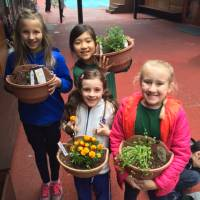 Students show off their newly transplanted seedlings. | COURTESY OF JON WALSH